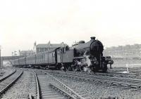 An unidentified Gresley V1 seen shortly after leaving Shettleston station with a Hyndland - Easterhouse service in April 1958. The train is passing Shettleston Junction, with the NB route to Bothwell and Hamilton turning south [see image 35603].<br><br>[G H Robin collection by courtesy of the Mitchell Library, Glasgow&nbsp;28/04/1958]