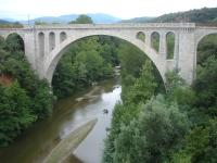 The impressive 1885 Pont ferroviaire de Ceret viaduct, across the Le Tech river at the eastern side of Ceret, on the remaining section of the branch line that originally ran from Elne to Arles-sur-Tech; but no longer exists beyond the former Ceret station sited some 700 metres to the left. Most of the final section between St-Jean-Pla-de-Corts yard and Ceret station is now mothballed and overgrown.  <br><br>[David Pesterfield&nbsp;01/08/2015]