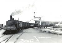 Shunting at Ardrossan Winton Pier on a sunny 6 July 1959 is McIntosh 3F 0-6-0T 56282. The 1898 veteran survived until April 1962 at the nearby Ardrossan shed.  <br><br>[G H Robin collection by courtesy of the Mitchell Library, Glasgow&nbsp;06/07/1959]