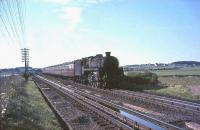 Corkerhill Standard Class 5 4-6-0 no 73122 passing over Stawfrank troughs with an up relief WCML service on 17 July 1965. <br><br>[John Robin&nbsp;17/07/1965]