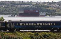 Lower Block 04 of the new carrier <I>Prince of Wales</I> heads down the River Clyde en route to Rosyth and is passed by a combined Oban and Mallaig service to Glasgow.<br><br>[Ewan Crawford&nbsp;16/08/2015]