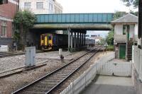 FGW Sprinter 150263 leaves Exeter Central and immediately begins the steeply graded descent to St. David's station with a service from Exmouth to Barnstaple. The signal box is no longer in use but lingers on alongside the line. <br><br>[Mark Bartlett&nbsp;29/07/2015]
