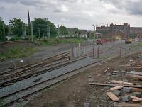 The monotony of the daily commute used to be slightly relieved by seeing what was in the yard at Partickhill. In latter days this was mostly engineering trains, as seen in this 1987 view. The yard had been re-ballasted and a secure area set up, probably for use with the Yoker resignalling trains. In the 1970s I recall tank wagons (perhaps en route to Bowling?) and burning piles which may have been from wagon disposal.<br><br>[Ewan Crawford&nbsp;//1987]