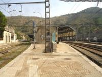 View south along the lengthy platform at Portbou, first station in Spain on the line running between Perpignan and Barcelona Sants, with the external easternmost lines on the left showing a lack of regular use. These lines are standard gauge, electrified at 25KV for the occasional SNCF services that run beyond Cerbere. A 3 coach Rodalies de Catalunya EMU can just be seen under the station roof, after arrival on a service from Barcelona Sants, and a number of Renfe Mercancias Bo-Bo electric freight locos are stabled over on the right. The large freight yard is located beyond the stabled locomotives.<br><br>[David Pesterfield&nbsp;07/08/2015]