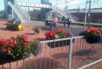 Planters maintained by 'Lockerbie in Bloom' give a welcoming appearance to this station, which is the railhead for a large area of South-West Scotland. <br><br>[John Yellowlees&nbsp;17/08/2015]
