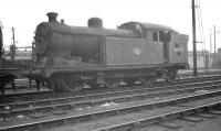 N7 69730 stands in the sidings at Stratford shed on 9 October 1961. The former Great Eastern 0-6-2 tank was officially withdrawn from here that same month and cut up in the nearby works scrapyard shortly thereafter.<br><br>[K A Gray&nbsp;09/10/1961]