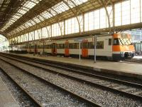 A 3 coach Renfe Rodalies de Catalunya liveried EMU stands under the impressive overall roof at Portbou on the afternoon on 7 August 2015, awaiting departure on the next service towards Barcelona Sants.<br><br>[David Pesterfield&nbsp;07/08/2015]