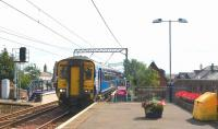 The 15.03 ex Girvan speeds through Prestwick Town on 17 August. This train runs non-stop from Ayr to Kilwinning and thence stops only at Paisley Gilmour Street prior to reaching Glasgow Central.<br><br>[Colin Miller 17/08/2015]
