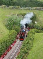 A train on the miniature Beer Heights railway emerges from the tunnel on its way back to the main station. Trains pass through the long tunnel twice while making a scenic circuit of the line and on the far side emerge onto a headland with panoramic views. <br><br>[Mark Bartlett&nbsp;01/08/2015]
