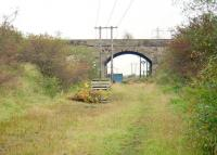 The viaduct carrying the L&A route from Kilbirnie Junction to Kilwinning East (closed 1953) over the closed GPK&A route from Dalry to Kilmarnock (closed 1973) just to the north east of Kilwinning. View south east in 1996. Redstone Siding was behind the camera.<br> <br><br>[Ewan Crawford&nbsp;//1996]