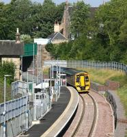 The 0944 2Z20 ex-Newcraighall clears Station Road bridge to arrive at Gorebridge on 23 August 2015 during a Sunday morning crew training trip to Tweedbank.<br><br>[John Furnevel&nbsp;23/08/2015]