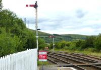 Down starters at Girvan on 12 August 2015. The tall signal refers to platform 2, the other to Platform 1. The main station building is located on platform 1, whereas platform 2 has nothing, not even a plastic shelter. Platform 1 appears to be used at all times other than when a crossing movement is required.<br><br>[Colin Miller&nbsp;12/08/2015]