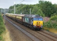 DRS 57301 hauling a <I>Northern Belle</I> service from Warrington to Edinburgh on 15 August 2015, seen here shortly after passing the site of Boars Head Junction.<br><br>[John McIntyre&nbsp;15/08/2015]