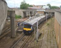 Looking down at the junction between east and westbound lines at Exhibition Centre station on 2 August 2015 as an eastbound service heads for the city centre.<br><br>[John McIntyre&nbsp;02/08/2015]