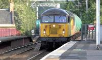Colas Railfreight 56078, working the 4N47 Prestwick Airport to Ineos Grangemouth empty aviation fuel tanks, runs north through Coatbridge Central on 14 July 2015.<br><br>[Ken Browne&nbsp;14/07/2015]