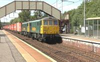 The 4M74 Coatbridge FLT to Crewe Basford Hall containers passing through Holytown station on 14 July 2015 behind Freightliner locomotives 86607+86613. <br><br>[Ken Browne&nbsp;14/07/2015]