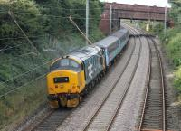 Recently returned to service with DRS, 37401 <I>Mary Queen of Scots</I> has retained its large logo livery and made a fine sight on 27th August 2015 propelling the 0515 Carlisle to Preston service through Hest Bank.<br><br>[Mark Bartlett&nbsp;27/08/2015]