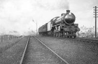 A train leaving Peterhead for Aberdeen on 19 May 1949. B1 4-6-0 no 61345 had been delivered new from Gorton works to Ferryhill six weeks earlier, before being moved across the city to Kittybrewster three days before this photograph was taken. [Ref query 17693]<br><br>[G H Robin collection by courtesy of the Mitchell Library, Glasgow&nbsp;19/05/1949]