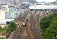 View over the east end of Waverley from Regent Road on a wet and overcast 27 August 2015. The Voyager heading for the Calton Tunnel is the CrossCountry 0900 Glasgow Central - Penzance, a class 67 is stabled in the sleeper loco bay, while a 158 stands at platform 4 with the 1024 to Newcraighall.<br><br>[John Furnevel&nbsp;27/08/2015]