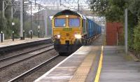 The Northenden to Folly Lane (Runcorn) '<I>Binliner</I>' containers, heading north through Acton Bridge on 27 July 2015 behind Freightliner 66551.<br><br>[Ken Browne&nbsp;27/07/2015]