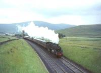 Standard class 5 4-6-0 no 73064 approaching the A74 bridge south of Crawford on 10 July 1965 with a CTAC special heading for Leicester.<br><br>[John Robin&nbsp;10/07/1965]