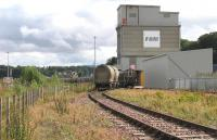 Freightliner Heavy Haul services from Oxwellmains to Aberdeen and Inverness now convey – thanks to award of Freight Facilities Grant – bogie vans of bagged cement which formerly moved by road. Both hopper wagons and vans can be seen in this shot of the Lafarge cement terminal deep in Millburn Yard, Inverness on 28th August 2015.<br><br>[David Spaven&nbsp;28/08/2015]