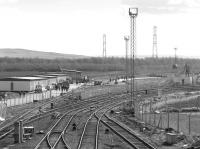 View south at Millerhill in March 1987 with the main yard behind the camera. The Bilston Glen branch bears right and the new ECML Electrification Depot is taking shape on the left.<br> <br><br>[Bill Roberton&nbsp;18/03/1987]