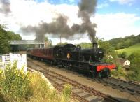 Churchward ex-GWR small Prairie tank 4566 seems to be sending smoke signals as it leaves Highley for Kidderminster in August 2015. Notice the cattle loading pen to the left. For the same engine 36 years previously [see image 41529]. <br><br>[Ken Strachan&nbsp;26/08/2015]