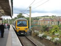 Northern EMU 323225 slows for the stop at the Glossop branch terminus on 1st September 2015. It is on a service from Hadfield that will reverse here and continue to Manchester Piccadilly. <br><br>[Mark Bartlett&nbsp;01/09/2015]