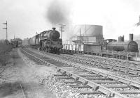 BR Standard Class 4 2-6-0 no 76100 on a Balloch to Carmyle train in April 1958. Caley 'Jumbo' 57314 is standing in the Gasworks siding with mineral wagons.  <br><br>[G H Robin collection by courtesy of the Mitchell Library, Glasgow&nbsp;12/04/1958]