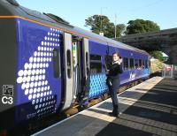 <I>'Hello! It's good to be back!'</I> The first scheduled passenger train on the Borders Railway calls at Newtongrange on 6 September 2015 on its way from Tweedbank to Edinburgh.<br><br>[John Furnevel&nbsp;06/09/2015]