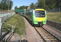 The first train south on 6 September 2015, the 0911 Edinburgh Waverley - Tweedbank, runs under Station Road bridge and is about to arrive at the platform at Gorebridge station on a fine and sunny Sunday morning. Leading unit is, appropriately, ScotRail 170414 in Borders Railway livery. <br><br>[John Furnevel&nbsp;06/09/2015]