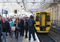 Crowds pour off the (bang-on-time) 09.40 arrival of the first ScotRail train from Tweedbank at Waverley on Sunday 6th September.<br><br>[David Spaven&nbsp;06/09/2015]