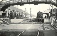 A Glasgow St Enoch - Largs train calls at Stevenston on 4 April 1959. The locomotive simmering gently at the platform is Fowler 2P 4-4-0 no 40667, with only 6 months to go before its eventual withdrawal from Ardrossan shed. View is east over Station Road level crossing.<br><br>[G H Robin collection by courtesy of the Mitchell Library, Glasgow&nbsp;04/04/1959]