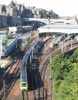 The first ScotRail train from Edinburgh to Tweedbank – the 09.11 departure on Sunday 6th September – threads its way towards Calton Tunnel. The shot continues a long Spaven family tradition of photography from this classic viewpoint [see image 27732].<br><br>[David Spaven&nbsp;06/09/2015]
