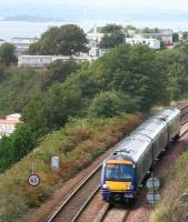 A Fife Circle train skirting Pettycur Bay on 8 September 2008 is about to enter Kinghorn Tunnel. The 'scaffolding and bandages' on the Forth Bridge can be made out in the left background, despite the sea mist hanging over the Forth on this particular morning.<br><br>[John Furnevel&nbsp;08/09/2008]