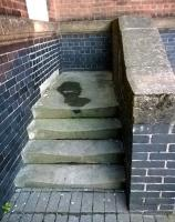 Perhaps they bricked up the door because the steps were worn out? These steps are located to the right of Nuneaton's main station entrance, below the clock tower. [See image 35705]<br><br>[Ken Strachan 01/09/2015]