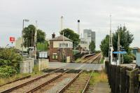 Tutbury and Hatton station, looking towards Derby on 30 August. The original station closed in 1966 but reopened in 1989 with platforms staggered either side of the level crossing. The large factory in the background is owned by Nestle and was rail served until the 1970s. <br><br>[Mark Bartlett&nbsp;30/08/2015]