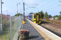 Ahh, the novelty of boarding a train at Newcraighall - and going south. I'm just about to do so as a 4-car 158 pulls in heading for Tweedbank on 8 September 2015, the third day of Borders rail services.<br><br>[David Panton&nbsp;08/09/2015]