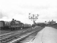 Ex-Caledonian 0-6-0 57569 trundles through Kilmarnock with a down freight on 6 May 1954.<br><br>[G H Robin collection by courtesy of the Mitchell Library, Glasgow&nbsp;06/05/1954]