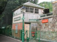 The station at Bere Ferrers, seen from a train on the Gunnislake branch in July 2015. The signal box is part of a small railway heritage centre and was formerly at Pinhoe on the LSWR main line. It carries the name <I>Beer Ferris</I>, which was the station's name until 1897.<br><br>[Mark Bartlett&nbsp;29/07/2015]