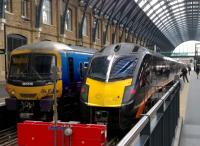 The class 365 on the left looks happy enough at Kings Cross on 2 September 2015, but the Grand Central 180, Adelante, on the right looks downright menacing.<br><br>[Ken Strachan&nbsp;02/09/2015]