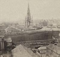 A portion of a stereo image of Edinburgh Canal Street station (called Princes Street after 1862) viewed from the east. The left portion of this image - where the terminus's station building stands, is now part of Waverley station, although that station's lines are at right angles to those seen here. The right portion became Waverley Market. A tightly curved line ran from the portal of the Scotland Street Tunnel to join the Edinburgh and Glasgow line. Canal Street itself became the 'in' ramp to Waverley station. Canal Street station and the tunnel were replaced by the lines via Easter Road. [Date unknown, possibly a GWW image.]<br><br>[Ewan Crawford Collection&nbsp;//]