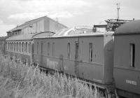 Ex-LMS coach converted to a 'dome car' for observation of pantograph/OHL.  Stored in the sidings at Thornton yard in the summer of 1987. [Ref query 7904]<br><br>[Bill Roberton&nbsp;25/07/1987]