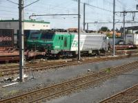 Consecutively numbered SNCF Fret Alstom Prima class 25KV AC electric locos 427029 & 427030 stand on adjacent tracks in Le Boulou east side road to rail transhipment yard in August 2015 attached to empty rakes of Lorry Rail piggyback wagons. A near fully loaded rake stands alongside the far loco.<br><br>[David Pesterfield&nbsp;05/08/2015]
