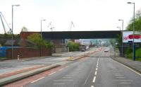 Looking east along the A8 in Greenock towards Glasgow in April 2007, showing the lengthy Caledonian Railway bridge that carried the line over the road and into James Watt Dock on the left.  [See image 15506]  <br><br>[John Furnevel&nbsp;29/04/2007]
