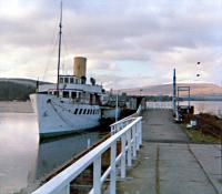 The PS <i>Maid of the Loch</i> at Balloch Pier after closure of the station but before lifting of the line. The removed overhead equipment between the Pier and Central stations at Balloch was used to electrify the line between Whifflet to Coatbridge Sunnyside.<br><br>[Ewan Crawford&nbsp;//1987]