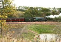 Already a distinctly autumnal look about the north end of Millerhill yard on 23 September as 60009 <I>Union of South Africa</I> brings up the rear of the empty stock of a steam special heading for Waverley. On the front of the train is 67026 <I>Diamond Jubilee</I>.<br><br>[John Furnevel&nbsp;23/09/2015]