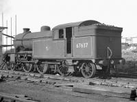Gresley V1 2-6-2T no 67637 stored alongside Heaton shed awaiting disposal in in early 1963. The locomotive was cut up at Darlington works in April the following year.<br><br>[K A Gray&nbsp;//1963]