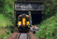 156449 on an Anniesland - Queen Street service emerges from the tunnel under the Forth and Clyde Canal on 23rd September 2015. Parts for the junction pointwork can be seen awaiting installation at the other end of the tunnel.<br><br>[Colin McDonald&nbsp;23/09/2015]